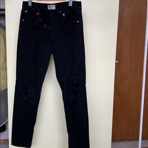 Agolde Black ripped knee jeans
